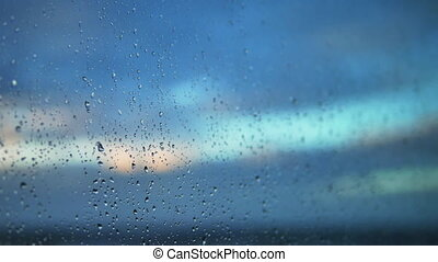 After the rain. Raindrops on a window. Focus the lens moves from left to right and in depth and back