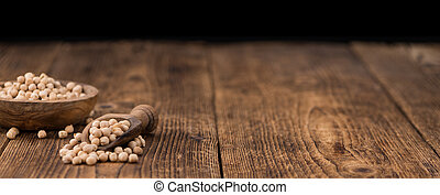 Portion of dried Chickpeas on wooden background, selective...