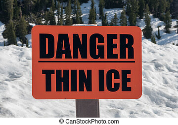 Orange Danger Thin Ice Sign Warns Hikers Exploring in Early...