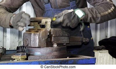 mechanic hands grind rusty metal with rasp tool in garage. -...