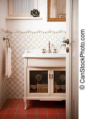 Vintage Bathroom. Wall tiles with floral patterns.