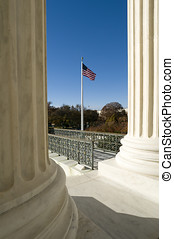 US Supreme Court Flag - Old Glory flying in front of the US...