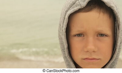 Portrait of a boy against the sea