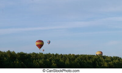 Balloons land beyond the forest - Air balloon land beyond...