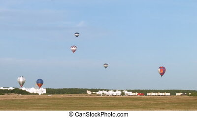 Balloons fly over aerodrome - Air balloons fly over...
