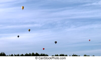 Balloons fly into the distance