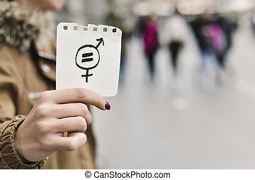 woman with a symbol for gender equality - closeup of a young...