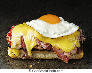 rustic french sandwich croque madam - close up of rustic...