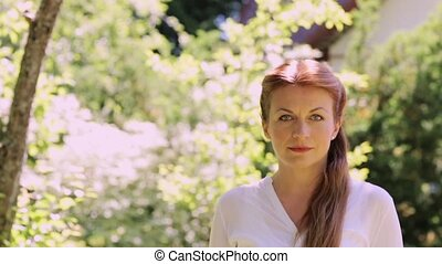portrait of happy smiling redhead woman outdoors - people,...