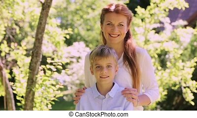 happy mother and little son outdoors - family, childhood and...