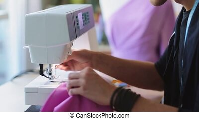 fashion designer with sewing machine working - people,...