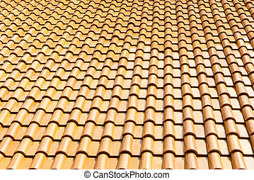 The glazed ceramic roof tile background.The texture of shiny...