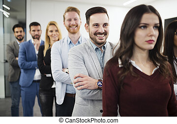 Team of cheerful businesspeople posing for group picture