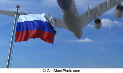 Commercial airplane landing behind waving Russian flag....