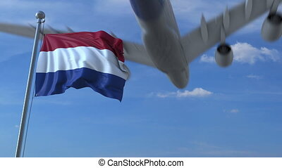 Commercial airplane landing behind waving Dutch flag. Travel to the Netherlands conceptual animation