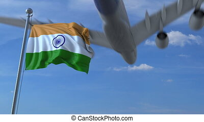 Commercial airplane landing behind waving Indian flag....