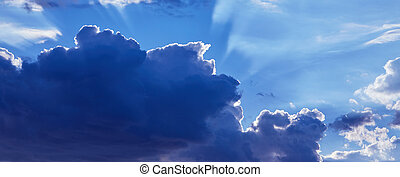 Beautiful blue sky with clouds background. Sunlight