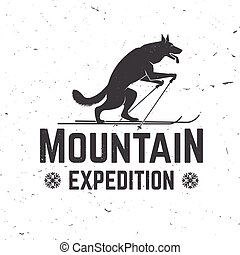Vintage typography design with wolf on the ski silhouette.