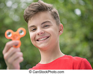 Teen boy with spinner