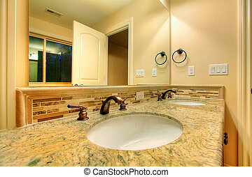 Countertop in bathroom - Bathroom with a tub and nice...