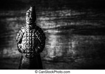 Terra Cotta Warriors on old brown background