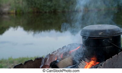 Cooking food at a campsite