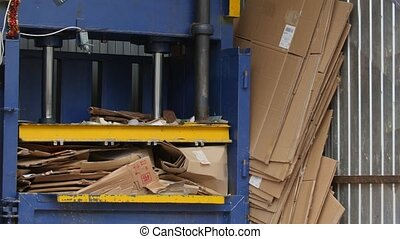 Industrial press- recycling of cardboard at industrial...
