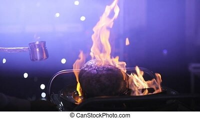 Cooking Meat on Fire. The Chef Cooks the Meat to the Viewers