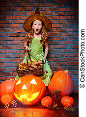 surprised girl witch - Pretty little girl in witch costume...