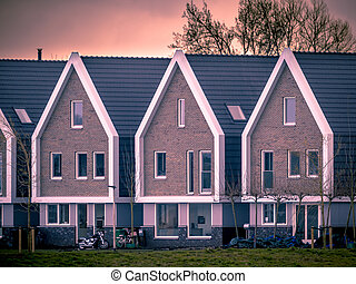 Row of modern houses at sunset vintage colors - Row of...