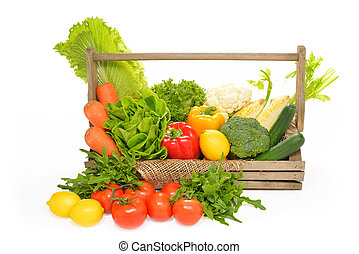 fruits and vegetables in wooden basket on white background