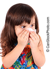 Little girl wiping nose with tissue - Little three year old...