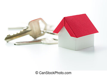 House and keys - Miniature red house and door keys over...