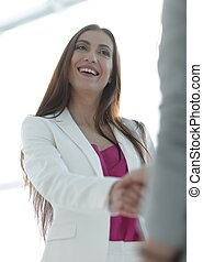 handshake, business woman and client - concept of trust....