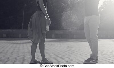Young woman standing on a square in the sunlight - Slow...