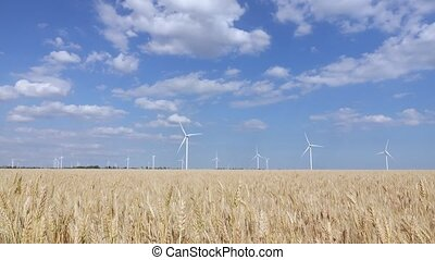 Panorama of beautiful landscape with wind generators in the...