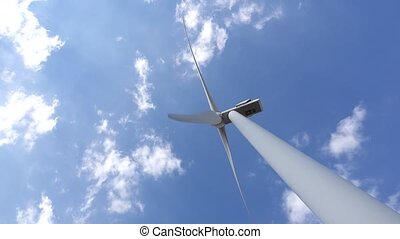 Wind turbine view from bottom against moving clouds. Close...