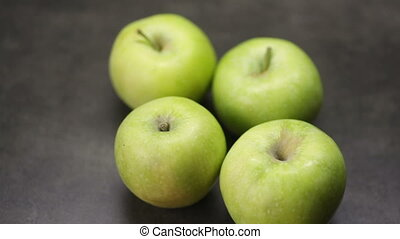 Green apples lie on the table.