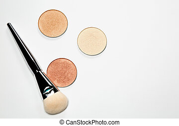 Set of highlighters with cosmetic brush over a white background