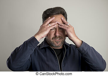 Adult Male Looking in Pain with Hands on Head