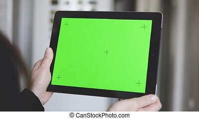 Woman Makes Pick Gestures on Tablet PC - Woman wear in black...