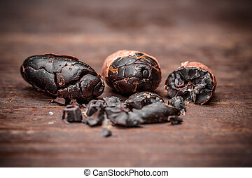 Cocoa beans on the old wooden background