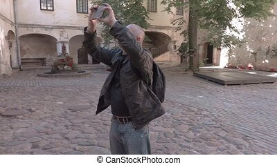 Tourist take pictures in the castle yard