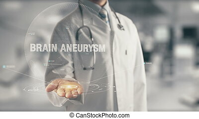 Doctor holding in hand Brain Aneurysm - Concept of...