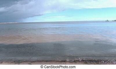 Peaceful sea before thunder