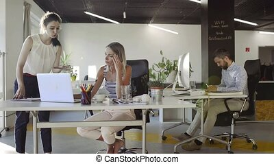 Three business people in the office working. - Three...