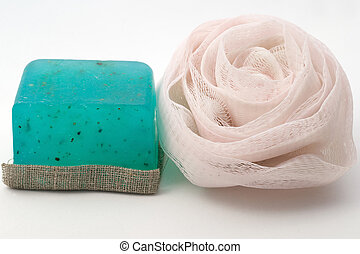 Fragrant soaps for SPA and sponge on a white background