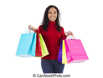 Shopping - Stock image of cheerful woman holding shopping...