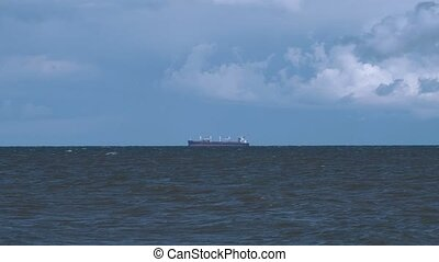 Fishing ship at sea in the distance