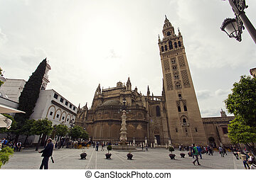 The Cathedral of Seville with the Giralda views from Piazza...